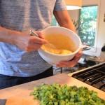 broccoli cheddar cornbread whisking